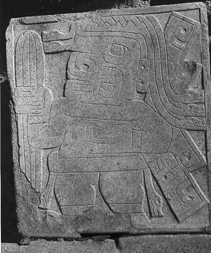 Being holding a San Pedro cactus engraved on wall at Chavin ceremonial site. (Image credit: Wiki Commons).