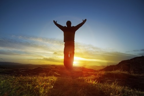 Spirituality levels vary throughout day we are most spiritual in a man with hands raised to greet the sunrise m4hsunfo